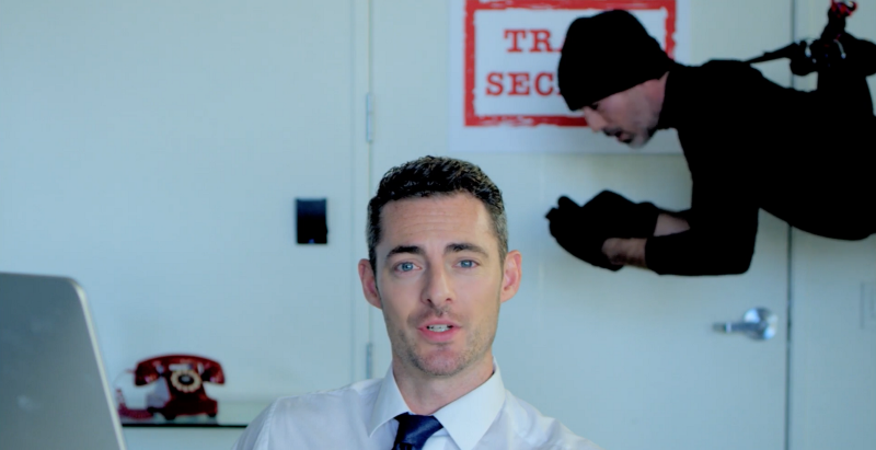 guy in office with thief behind him