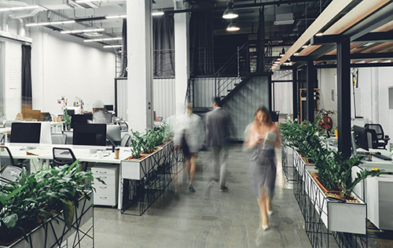 modern space with blurred people walking