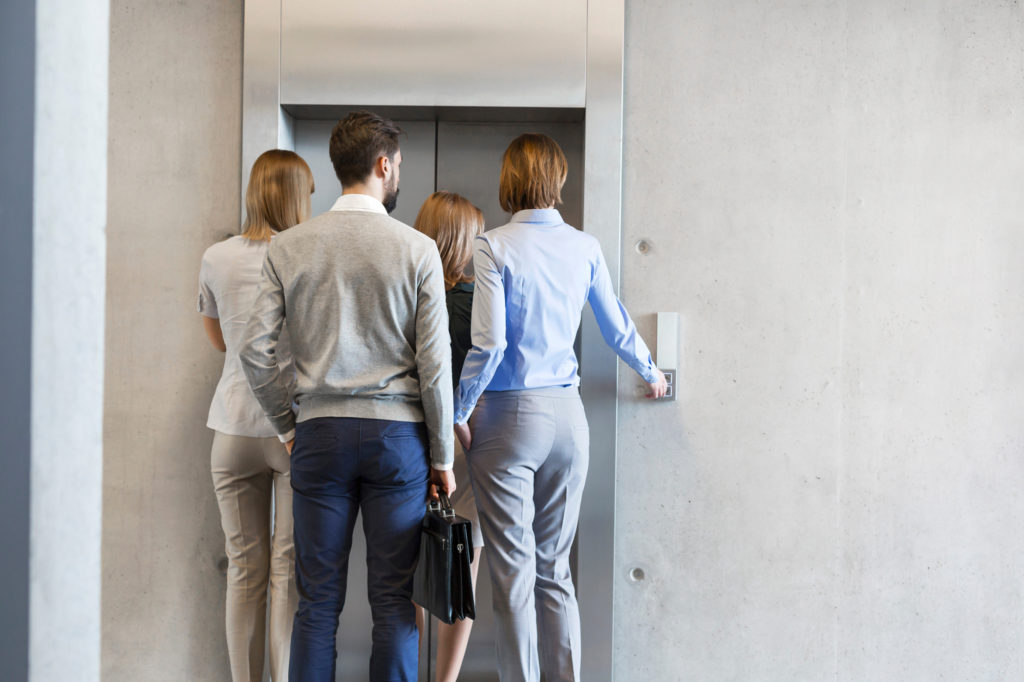 group of people waiting for elevator
