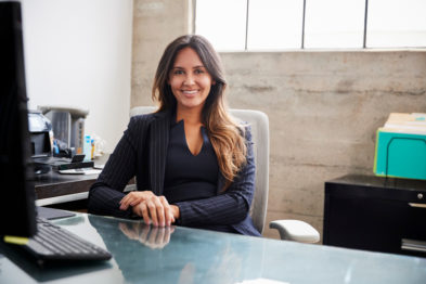 professional woman smiling at desk