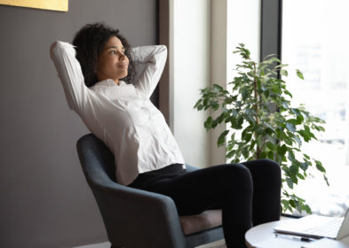 woman leaning back in chair