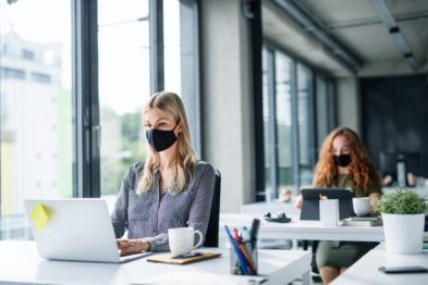coworkers in office with masks