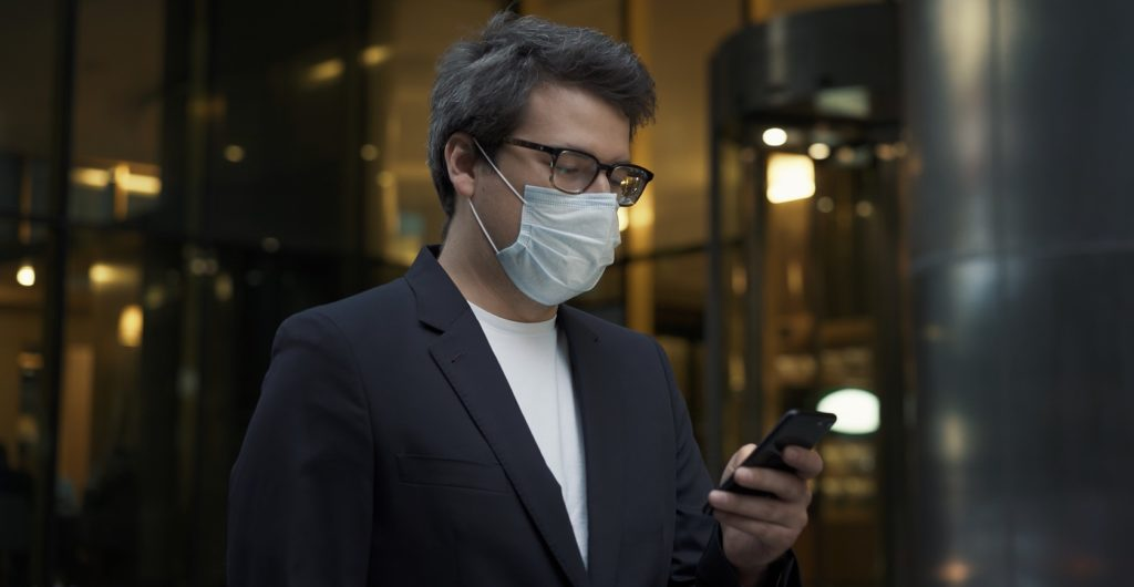 man entering building with mask